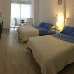 Отель Cancun Plaza Condo комната для гостей фото 4