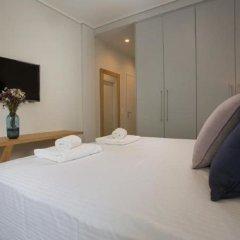 Апартаменты LeGeo-Luxurious Athenian Apartment комната для гостей фото 2