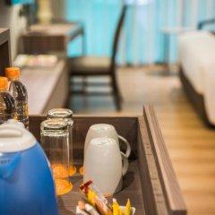 Отель Citrus Suites Sukhumvit 6 By Compass Hospitality Бангкок удобства в номере
