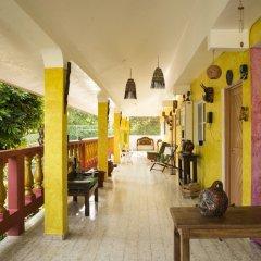 Отель Hostel Kiosco Verde Folk Room Мексика, Канкун - отзывы, цены и фото номеров - забронировать отель Hostel Kiosco Verde Folk Room онлайн вид на фасад фото 2