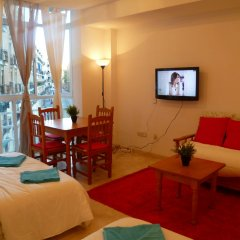Отель Village Atocha Apartments Испания, Мадрид - отзывы, цены и фото номеров - забронировать отель Village Atocha Apartments онлайн комната для гостей