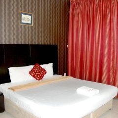 Отель Al Ferdous Hotel Apartment ОАЭ, Шарджа - отзывы, цены и фото номеров - забронировать отель Al Ferdous Hotel Apartment онлайн комната для гостей фото 3