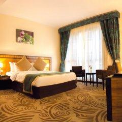 Отель Al Majaz Premiere Hotel Apartment ОАЭ, Шарджа - 1 отзыв об отеле, цены и фото номеров - забронировать отель Al Majaz Premiere Hotel Apartment онлайн комната для гостей фото 4