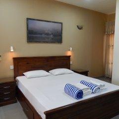 Отель Janishi Residencies сейф в номере
