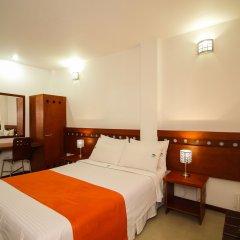 Отель Imbanaco Cali Колумбия, Кали - отзывы, цены и фото номеров - забронировать отель Imbanaco Cali онлайн комната для гостей фото 2