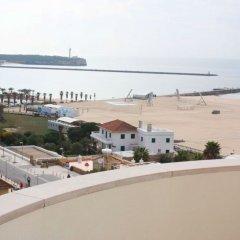 Отель Apartamentos Turisticos Algarve Mor Португалия, Портимао - отзывы, цены и фото номеров - забронировать отель Apartamentos Turisticos Algarve Mor онлайн пляж