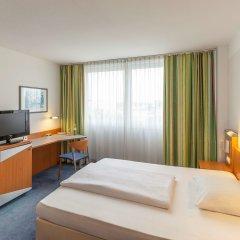 Отель Ramada by Wyndham Hannover Германия, Ганновер - отзывы, цены и фото номеров - забронировать отель Ramada by Wyndham Hannover онлайн комната для гостей