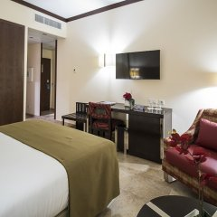 iu Hotel Sumbe удобства в номере