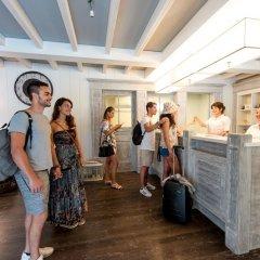 Отель Villaggio Conero Azzurro Италия, Нумана - отзывы, цены и фото номеров - забронировать отель Villaggio Conero Azzurro онлайн интерьер отеля