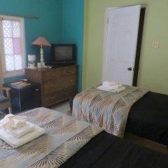 Отель Moxons Beach Club Boutique Hotel Ямайка, Монастырь - отзывы, цены и фото номеров - забронировать отель Moxons Beach Club Boutique Hotel онлайн комната для гостей фото 3