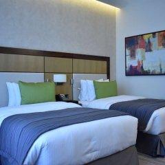 Отель Golden Tulip Al Thanyah комната для гостей