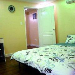 Отель Sk Condotel Филиппины, Пампанга - отзывы, цены и фото номеров - забронировать отель Sk Condotel онлайн комната для гостей
