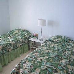 Отель Irie Beach Studio Ямайка, Монтего-Бей - отзывы, цены и фото номеров - забронировать отель Irie Beach Studio онлайн комната для гостей