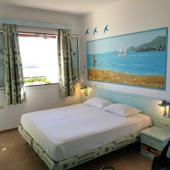 Апартаменты Haraki Mare Studios & Apartments Родос комната для гостей фото 2