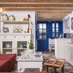 Отель Oia Sunset Villas Греция, Остров Санторини - отзывы, цены и фото номеров - забронировать отель Oia Sunset Villas онлайн комната для гостей фото 2