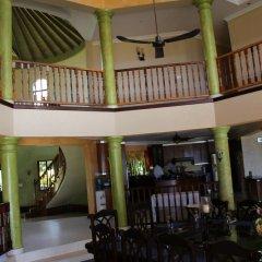 Отель Milbrooks Resort Ямайка, Монтего-Бей - отзывы, цены и фото номеров - забронировать отель Milbrooks Resort онлайн интерьер отеля