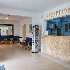 Отель Mavina Hotel and Apartments Мальта, Каура - 5 отзывов об отеле, цены и фото номеров - забронировать отель Mavina Hotel and Apartments онлайн интерьер отеля фото 2
