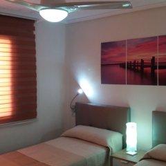 Отель Valencia Beach Suites Wifi Fibra комната для гостей фото 2
