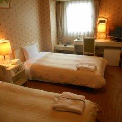 Отель Bougainvillea Shinjuku Япония, Токио - отзывы, цены и фото номеров - забронировать отель Bougainvillea Shinjuku онлайн комната для гостей фото 3