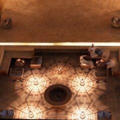Отель Anantara Al Jabal Al Akhdar Resort Оман, Низва - отзывы, цены и фото номеров - забронировать отель Anantara Al Jabal Al Akhdar Resort онлайн интерьер отеля фото 3