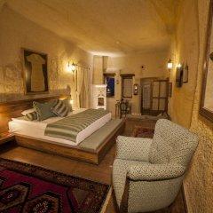 Отель Kayakapi Premium Caves Cappadocia комната для гостей фото 2