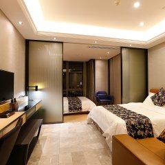 Апартаменты Pengman Beijing Rd. A-mall Apartment комната для гостей
