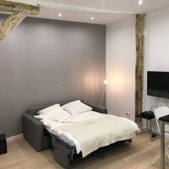 Апартаменты Exclusive New Apartment Heart Paris Париж комната для гостей