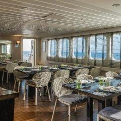 Отель Four Seasons Resort Maldives at Kuda Huraa