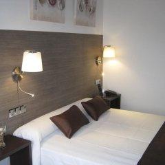 Отель Suites A Coruña комната для гостей