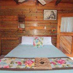 Отель Coconut Grove Beachfront Cottages комната для гостей фото 5