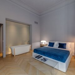 Апартаменты Santa Croce Deluxe 2 Bedroom Apartment Флоренция комната для гостей фото 4