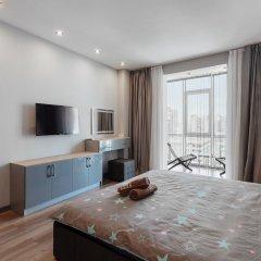 Апартаменты Arcadia Sky Apartments комната для гостей фото 3