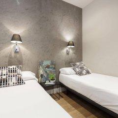 Апартаменты AinB Eixample-Miro Apartments комната для гостей фото 3