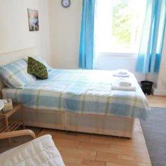 Апартаменты 4 Bedroom Apartment in Kilburn With Private Balcony комната для гостей