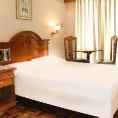 Отель Citadel Inn Makati Филиппины, Макати - отзывы, цены и фото номеров - забронировать отель Citadel Inn Makati онлайн комната для гостей фото 5