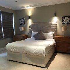 Апартаменты Beaufort Gardens Apartment Лондон комната для гостей фото 3