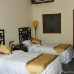Отель Soluxe Courtyard Китай, Пекин - отзывы, цены и фото номеров - забронировать отель Soluxe Courtyard онлайн комната для гостей фото 4