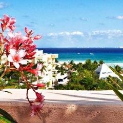 Отель Acanto Hotel and Condominiums Playa del Carmen Мексика, Плая-дель-Кармен - отзывы, цены и фото номеров - забронировать отель Acanto Hotel and Condominiums Playa del Carmen онлайн пляж фото 2