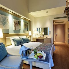 Отель Euphoria Aegean Resort & Spa All Inclusive Сыгаджик комната для гостей фото 5