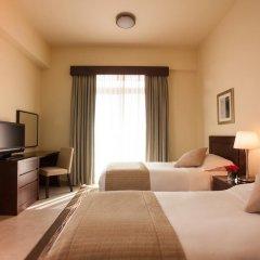 Апартаменты Movenpick Apartment Bur Dubai комната для гостей фото 5