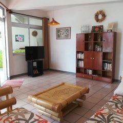 Отель Condo Ora Airport Фааа комната для гостей