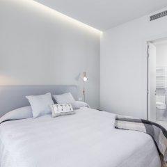 Отель Puerta Toledo Apartment by FlatSweethome Испания, Мадрид - отзывы, цены и фото номеров - забронировать отель Puerta Toledo Apartment by FlatSweethome онлайн комната для гостей