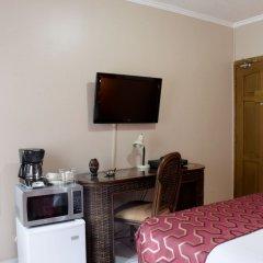 Отель Aparthotel Guijarros Гондурас, Тегусигальпа - отзывы, цены и фото номеров - забронировать отель Aparthotel Guijarros онлайн удобства в номере фото 2