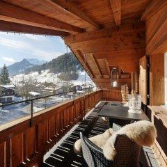 Отель Arc En Ciel Швейцария, Гштад - отзывы, цены и фото номеров - забронировать отель Arc En Ciel онлайн балкон