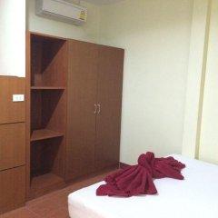 Отель TN Guesthouse сейф в номере