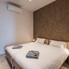 Отель Saint Julian's - Spinola Bay Apartment Мальта, Сан Джулианс - отзывы, цены и фото номеров - забронировать отель Saint Julian's - Spinola Bay Apartment онлайн комната для гостей фото 5