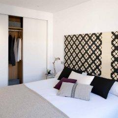 Отель Eric Vökel Boutique Apartments - Atocha Suites Испания, Мадрид - отзывы, цены и фото номеров - забронировать отель Eric Vökel Boutique Apartments - Atocha Suites онлайн комната для гостей фото 3