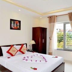 Отель Nuni Homestay Хойан комната для гостей