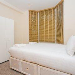 Отель 2 Bedroom Apartment In Fulham Великобритания, Лондон - отзывы, цены и фото номеров - забронировать отель 2 Bedroom Apartment In Fulham онлайн комната для гостей фото 2
