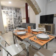 Апартаменты Santi Quattro Apartment & Rooms - Colosseo в номере